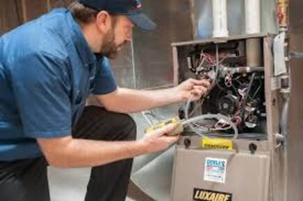 Man fixing furnace wires
